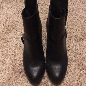 High black boots with silver zippers